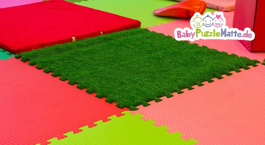 Puzzlematte Ökotest mit einem grünen Gras Feld in der Puzzlematte